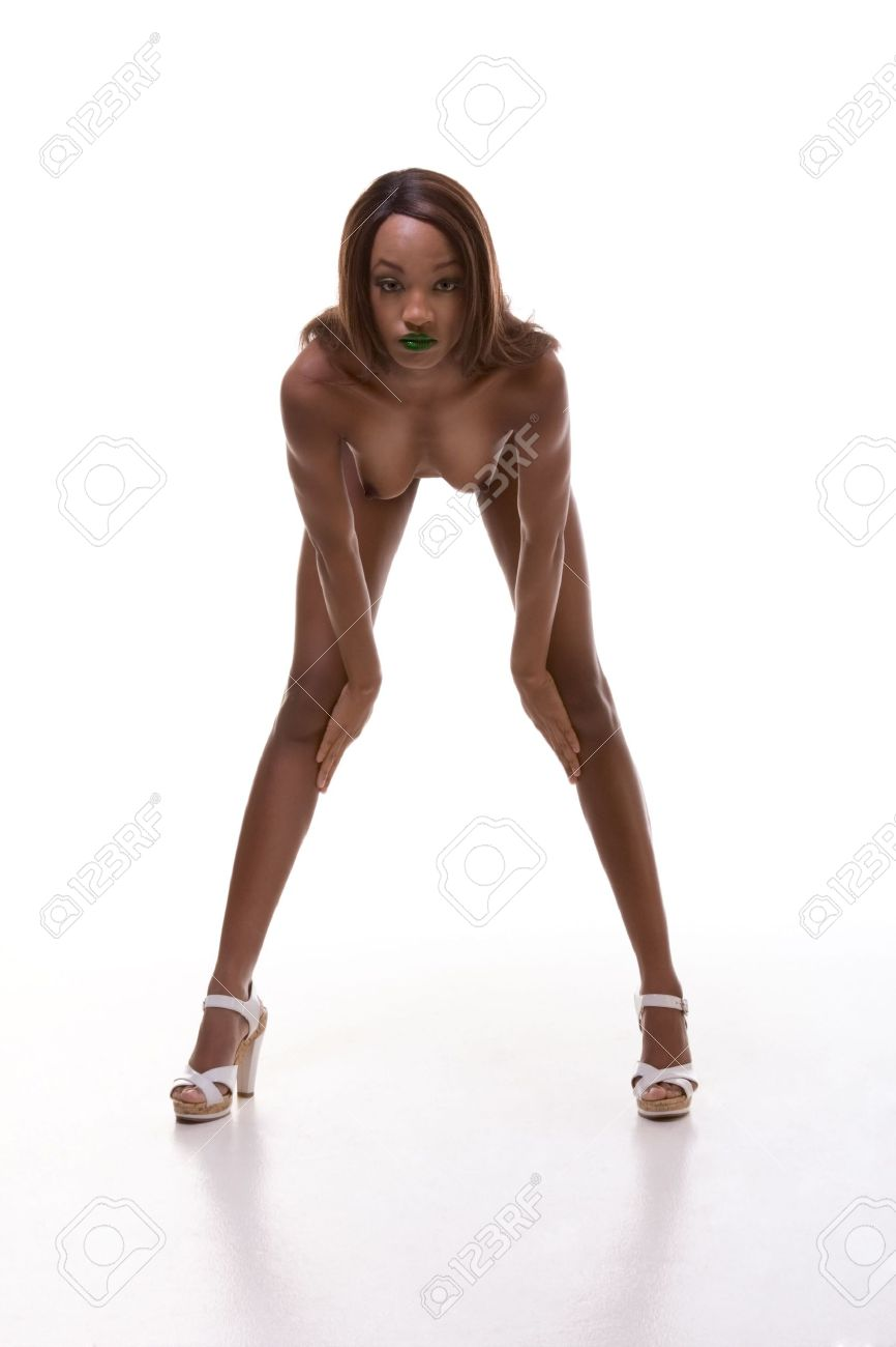 Black woman bending naked on bed