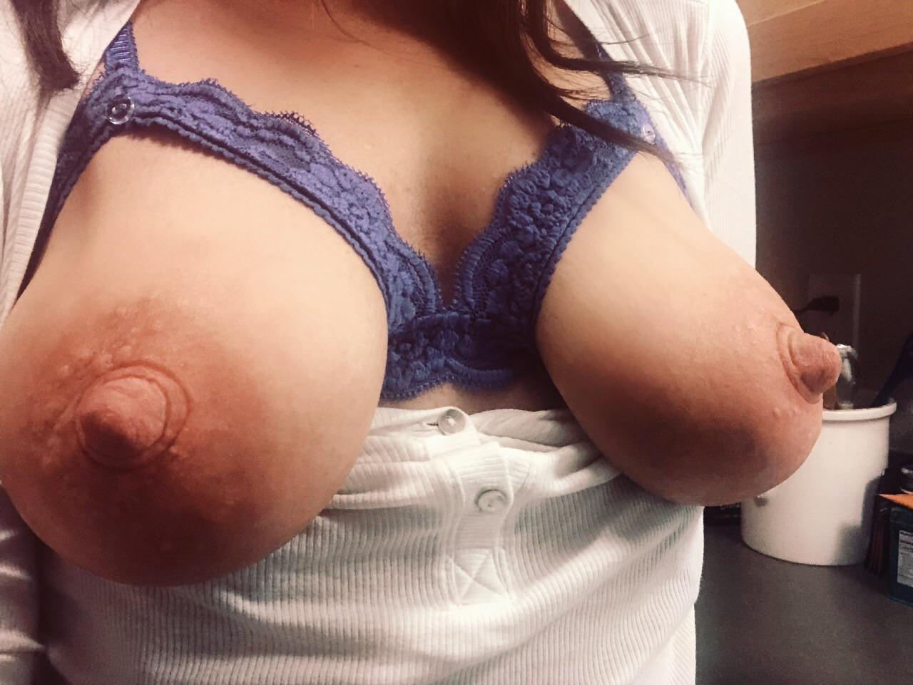 Saggy tits hanging out of bra